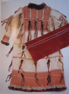 photo of actual bird skin tunic with a strip of Anisia's laying over it